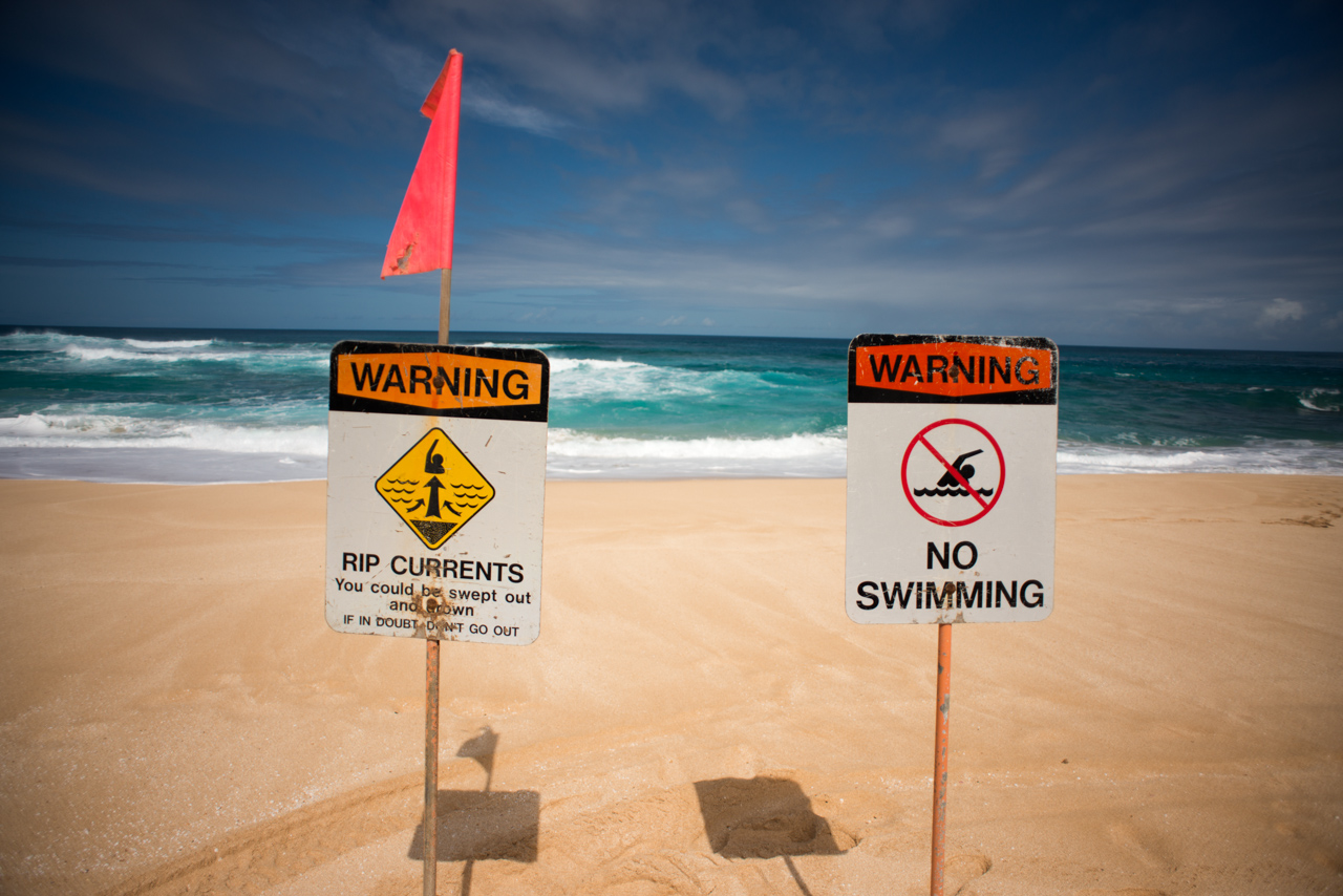 rip current, beach safety, warning sign