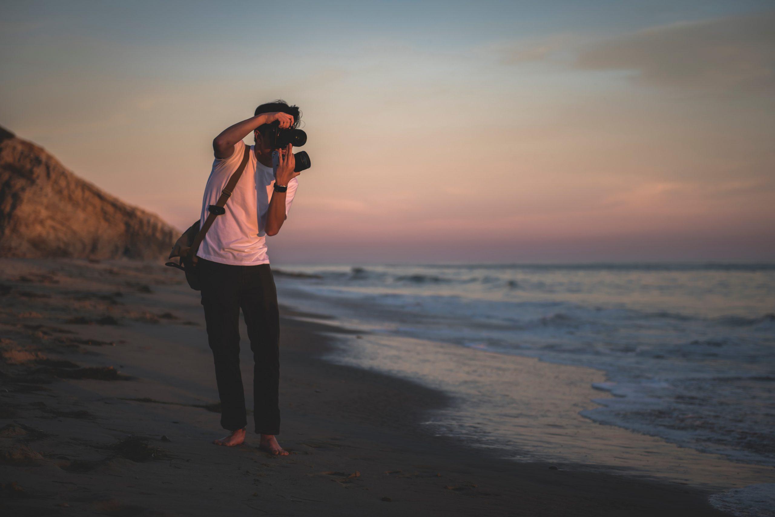 person-taking-photos-on-beach